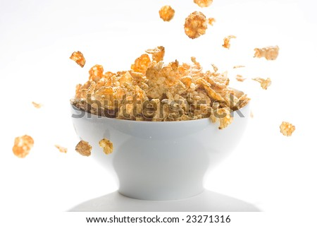 bowl of cereal with raisins, milk and orange juice