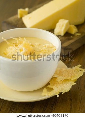 Bowl of cheese soup with cheese chips
