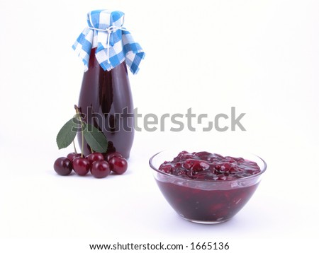 bowl of cherry jam and bottle of syrup isolated on white