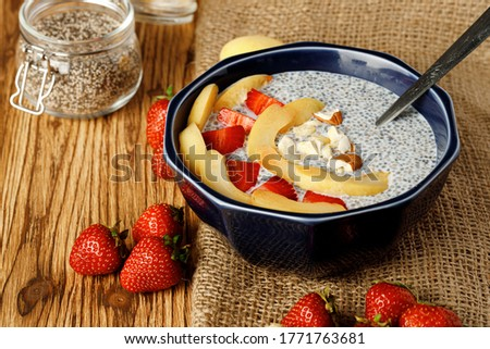 Bowl of chia poudding with pieces of apricots and strawberry Photo stock ©