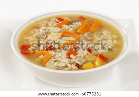 bowl of chicken and wild rice soup with vegetables