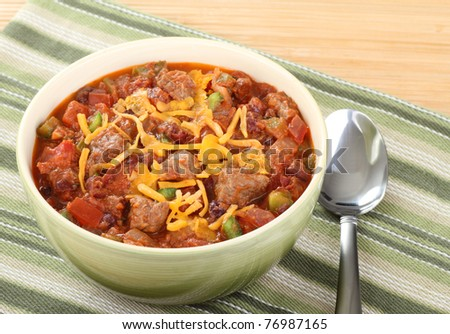 Bowl of chili with cheese on top