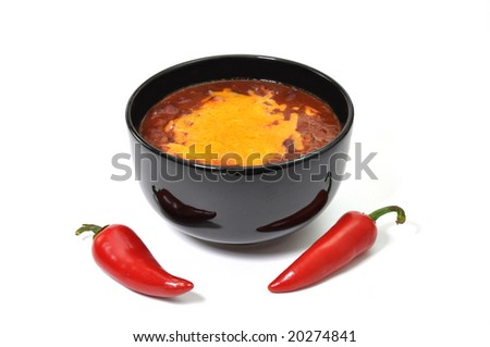 Bowl of chili with melted cheese and red cayenne peppers.  Isolated on white background.