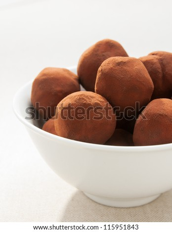 bowl of chocolate truffles on fabric