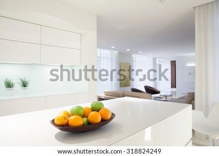 Bowl of citrus on white kitchen worktop