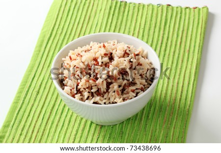 Bowl of cooked mixed rice - studio - stock photo