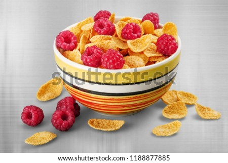 Bowl of cornflakes and raspberries #1188877885