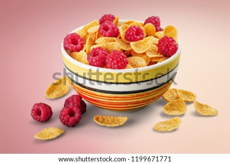 Bowl of cornflakes and raspberries #1199671771