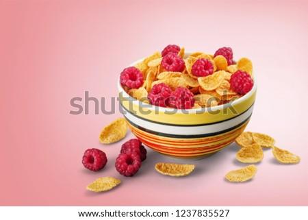 Bowl of Cornflakes and Raspberries #1237835527
