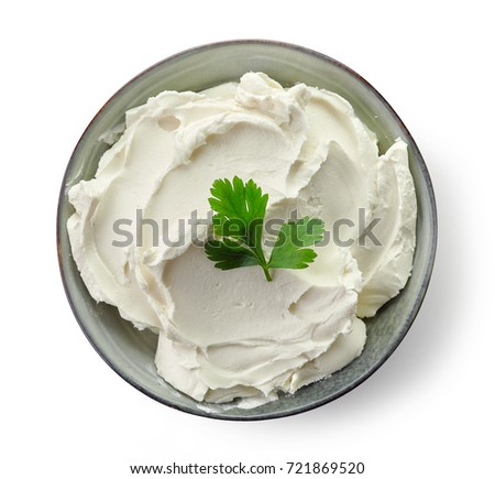 Bowl of cream cheese isolated on white background, top view