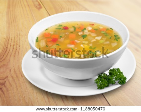 Bowl of delicious vegetables soup on  table