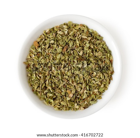 Bowl of dried oregano leaves isolated on white background, top view #416702722