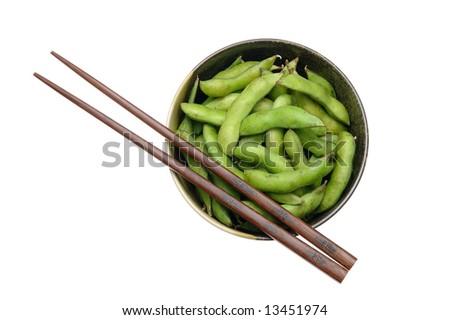 Bowl of edamame with chopsticks isolated on white