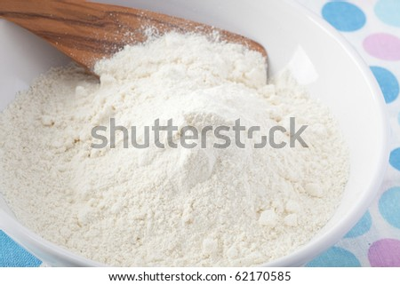 Bowl of flour ready for the next ingredients. - stock photo