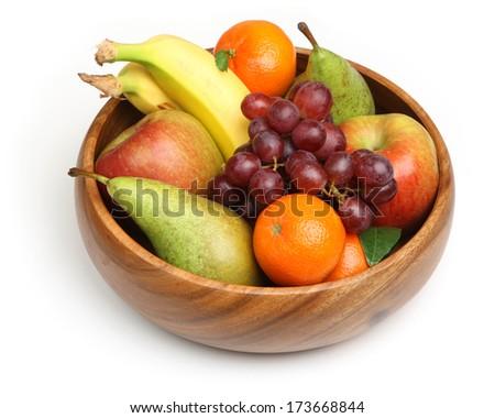 Bowl of fresh fruit, isolated on white background.