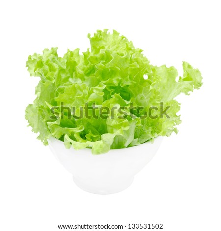 bowl of fresh green salad isolated on a white background