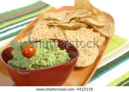 Bowl of fresh guacamole and crisp tortilla chips.