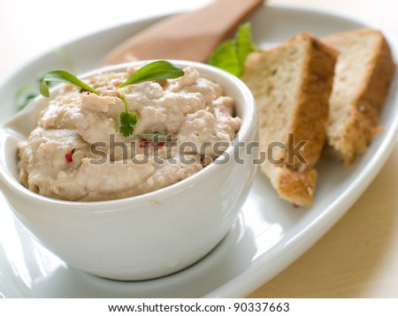 Bowl of fresh hummus dip with  bread slices, selective focus