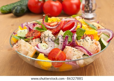 Bowl of Fresh Panzanella (Tuscan Tomato and Bread Salad) with Ingredients - stock photo