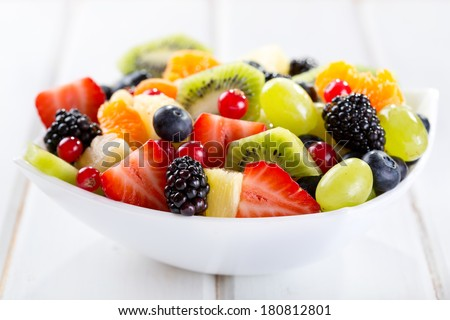 bowl of fruit salad on wooden table Stock photo ©
