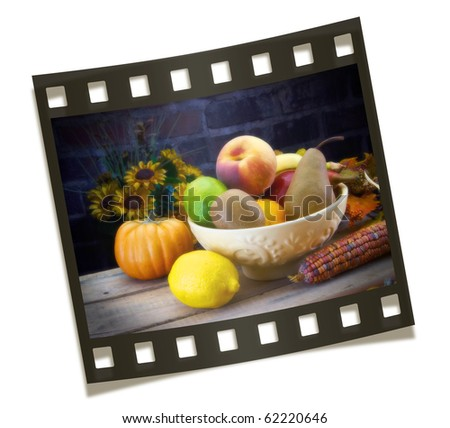 Bowl of fruit set in a fall set with sunflowers and corn set in a film strip STUDIO SHOT SOFT FOCUS