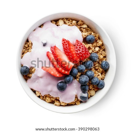 bowl of granola with yogurt and berries isolated on white background, top view