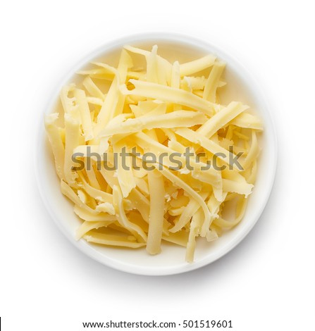 Bowl of grated cheese isolated on white background. top view