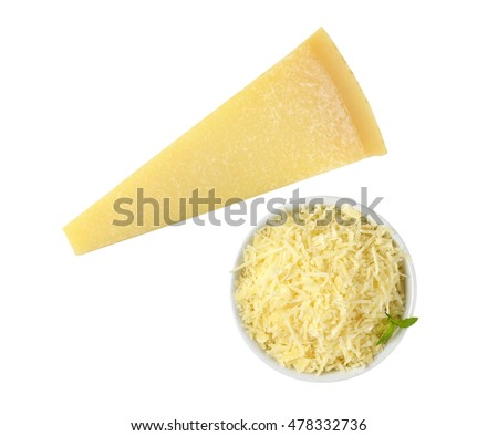bowl of grated parmesan and whole cheese wedge