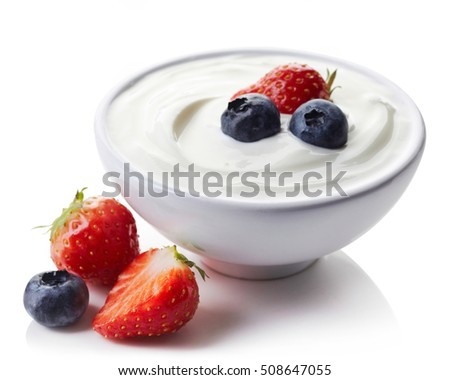 Bowl of greek yogurt and fresh berries isolated on white background #508647055