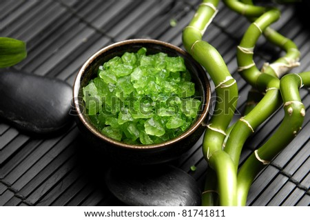 bowl of Green bath salt with zen stones and lucky bamboo on mat