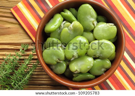 Bowl of green boiled broad beans