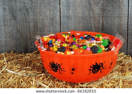 bowl of Halloween candy on straw