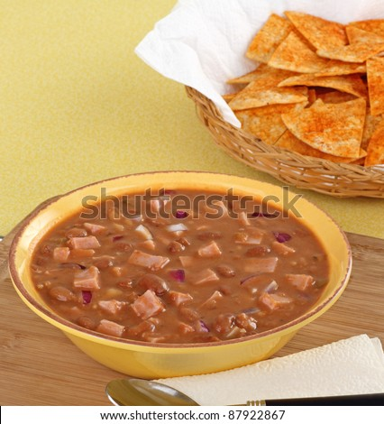 Bowl of ham and bean soup with tortilla chips