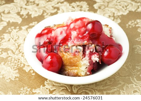 Bowl of homemade Cherry Cobbler on a horizontal background with copy space, great for Valentine's Day