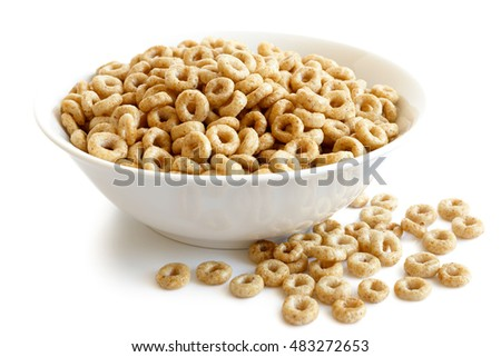 Shutterstock Bowl of honey cheerios isolated on white. Spilled cheerios.