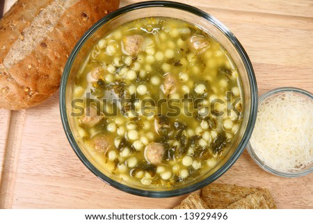 stock photo Bowl of hot Italian Wedding Soup meatballs and spinach soup
