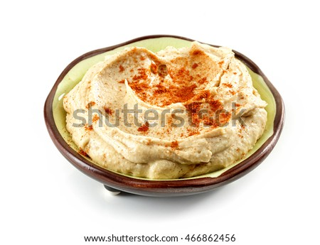 bowl of hummus isolated on white background