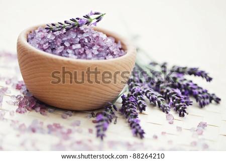 bowl of lavender bath salt with fresh flowers - beauty treatment /shallow DOF/