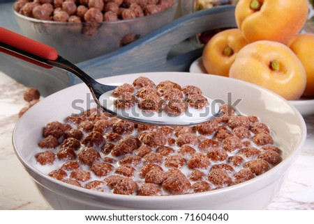 Bowl of milk and chocolate cereal with a spoon