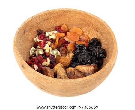 Bowl of mixed dried fruits in wooden bowl
