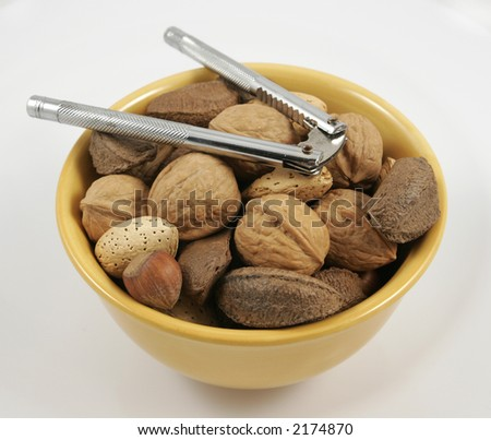 bowl of mixed nuts with nutcracker