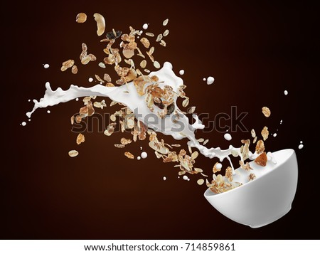 bowl of muesli with milk splash against brown background #714859861
