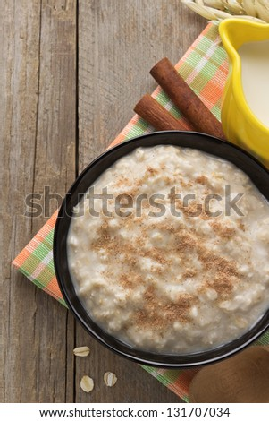 bowl of oatmeal on wood background