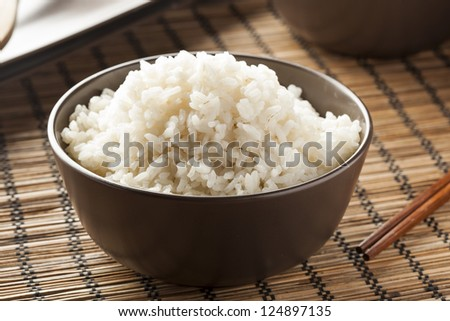 Bowl of Organic White Rice with chop sticks