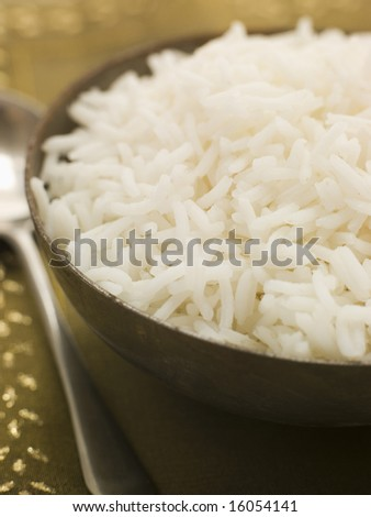 Bowl of Plain Boiled Basmati Rice with serving spoon