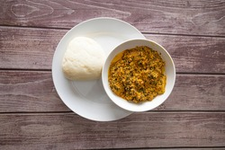 Bowl of Pounded Yam served with Egusi - Melon Soup