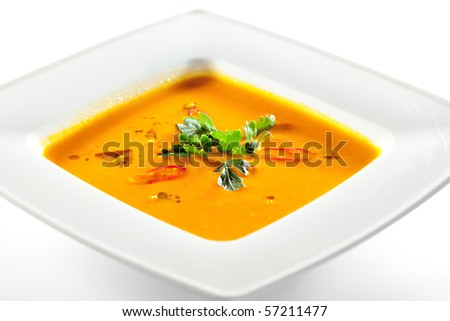 Bowl of Pumpkin Soup with Green Parsley