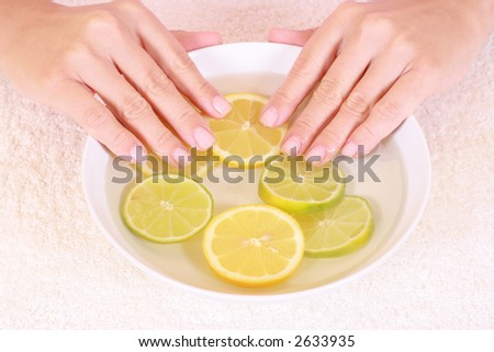 bowl of pure water with citrus fruits - hands care