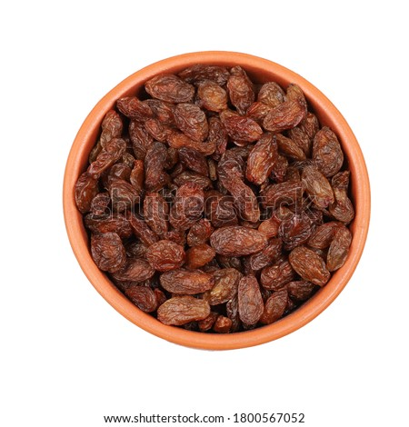 Bowl of raisins from the top on a white background Stock photo ©
