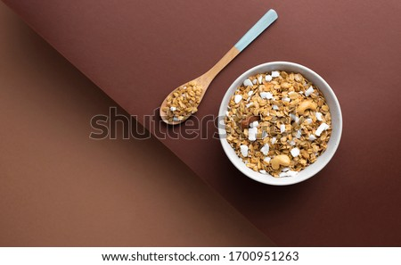 Bowl of raw granola on a brown modern paper background. Horizontal banner Stockfoto ©